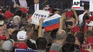 Protesters wave Russian flags at Trump rally