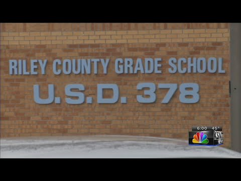 Man approaches student outside Riley County Grade School