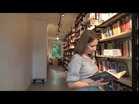 Woman Reading Inside A Library