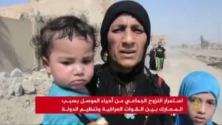 نزوح جماعي من أحياء مدينة الموصل