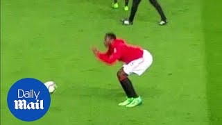 Pogba falls over after being hit between the legs with ball - Daily Mail