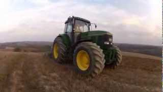 John Deere 7810 and 7800 with 3m cultivators working in Greece