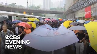 Hong Kong's pro-Democracy movement defies police orders, endures heavy rain for demonstration