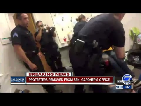 Disability advocates arrested by Denver police during sit-in at Cory Gardner