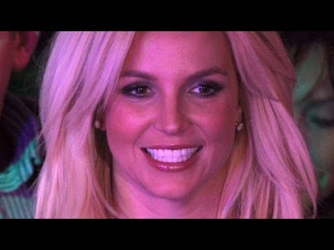 Britney Spears surprised a fan by serving him afternoon tea at London's Savoy Hotel. (Photo)