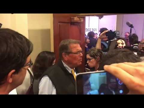 Roy Moore supporters argue with media after press conference