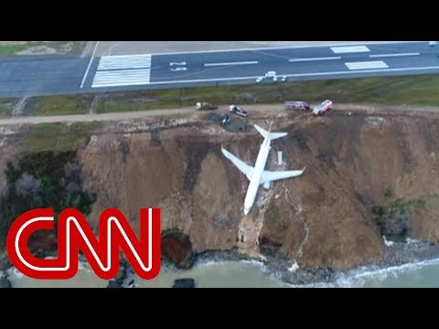 See Plane that Skidded off Runway Get Stuck Hanging Over Cliff!  Yikes!