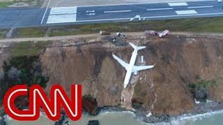 Plane skids off runway, gets stuck on cliff thumbnail