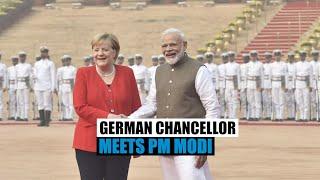German Chancellor Angela Merkel meets PM Modi, pays tribute to Gandhi
