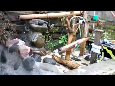 Kincir air bambu hiasan taman dan kolam ikan