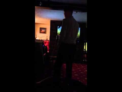 George Evans singing karaoke