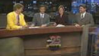 News Blooper: Sports Guy's Jacket Distracts News Anchors thumbnail