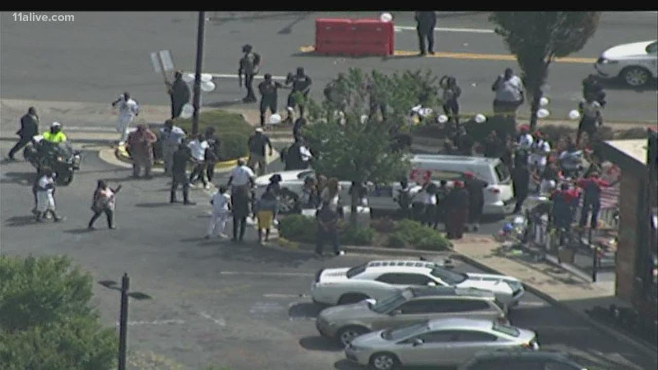 Part of Rayshard Brooks' funeral procession drives around the Wendy's where he was killed