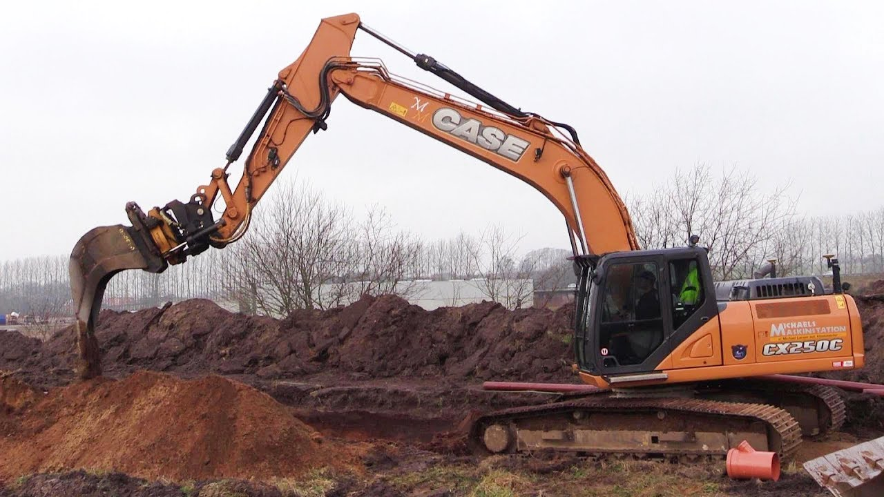 Case CX250C Excavator With 3D GPS And Engcon Tiltrotator Changing Buckets  And Digging A Sewer Trench