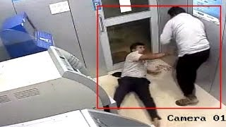 CCTV: Brave security guard foils ATM robbery