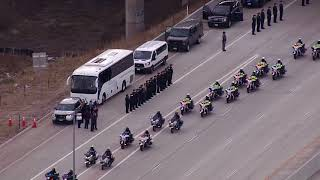 Powerful procession for slain Colorado deputy stretches for miles