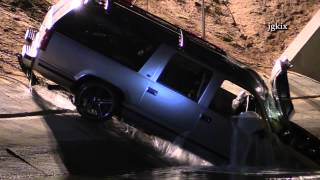Suv Ends Up In Aqueduct After Taking Out A Power Pole