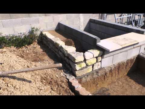 Construction d 39 un bassin poisson koi en b ton et brique for Construction bassin aquatique