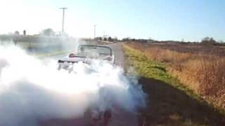 1964 impala with a 283 doing a burnout