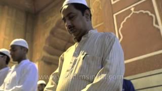 Muslims performing prayers before Iftar at the grand Jama Masjid