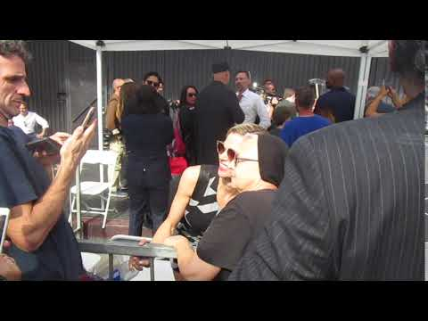 Brooke Burns greets a fan at Nick Nolte Walk Of Fame ceremony