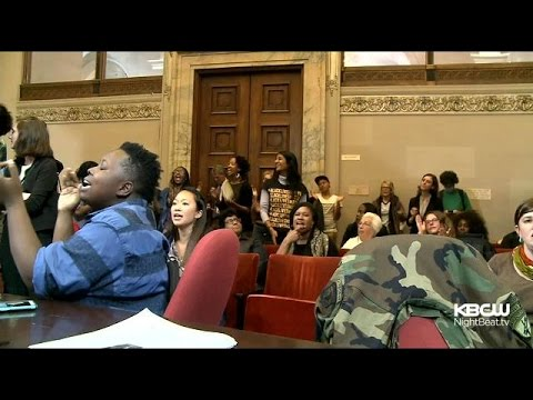 Protesters Chain Themselves Together In Oakland City Council Meeting