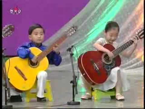 north korea kindergarten children playing guitar at chongam kindergarten youtube. Black Bedroom Furniture Sets. Home Design Ideas