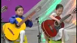 North Korea Kindergarten children playing Guitar at Chongam Kindergarten