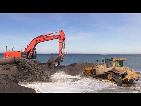 Cat D6T Dozer And Hitachi Zaxis 350 Excavator Working On A Land Reclamation Project