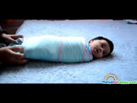 The easy way to swaddle a baby using easy bedung (Cara memakaikan bayi easy bedung) from YouTube · Duration:  47 seconds
