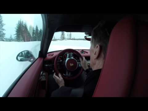 Walter Rohrl driving a Porsche 911 Turbo S in the snow