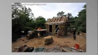 Straw Bale, Timber Frame, And Cob Hybrid Cottage From Foundation To Thatch Roof- Timelapse