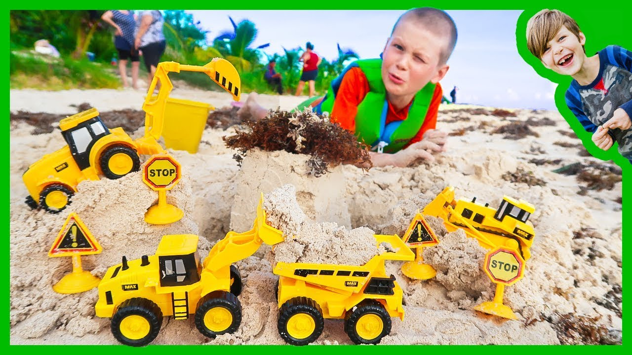 construction trucks for children digging sand at the beach youtube