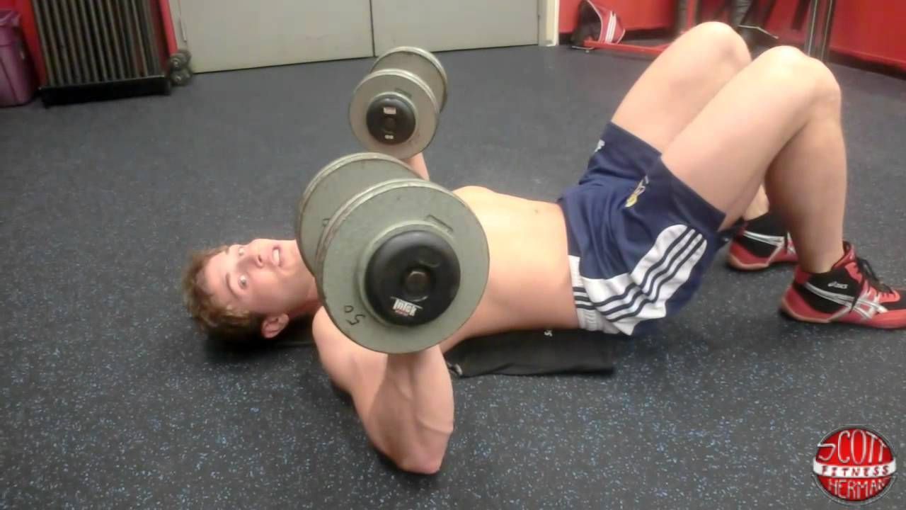 How To Dumbbell Laying Reverse Crunch Into A Floor Press Youtube