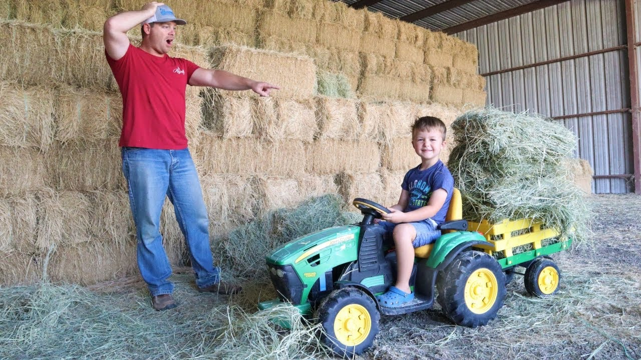 Using tractors to pick up a huge hay mess on the farm | Tractors for kids