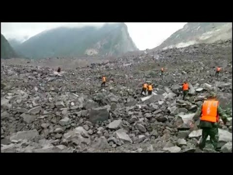 Around 100 people feared buried in China landslide--authorities