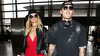 Paris Hilton And Chris Zylka Share The Love At LAX