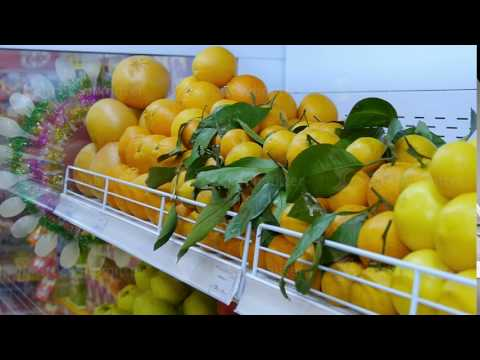Fresh organic vegetables and fruits on shelves in a supermarket, farmers market. The concept of