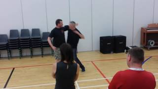 Demonstrating on Colin Steel.
