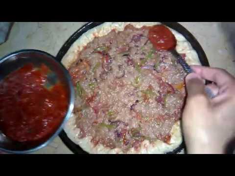 صورة  طريقة عمل البيتزا طريقة عمل بيتزا بالتونة بكل خطواتها طريقة عمل البيتزا من يوتيوب