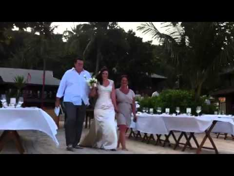 Leah walks down the sandy aisle