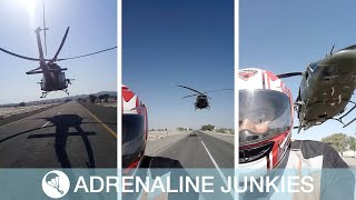 Motorcyclist Rides Under Low-Flying Helicopter