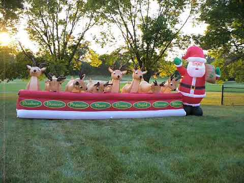 ShopChristmasInflatables.com Animated Reindeer Feeding With Santa Christmas  Airblown Inflatable