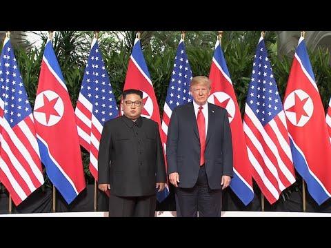 President Trump meets Kim Jong Un for start of historic summit