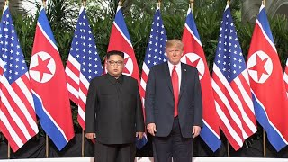 President Trump meets Kim Jong Un for start of historic summit
