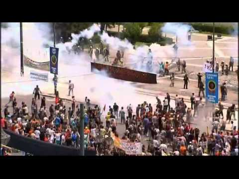 Greece passes austerity plan as protests continue