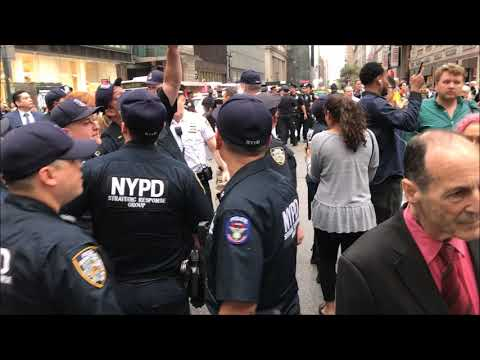 NYPD, RESPONSIBLY, PROFESSIONALLY & EFFICIENTLY HANDLING A SMALL PROTEST IN MIDTOWN, MANHATTAN, NYC.