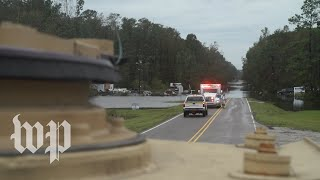 Rescue teams navigate the streets of Wilmington, N.C. as rain continues