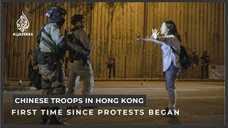 Chinese soldiers on Hong Kong streets for first time since protests began