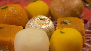 Assorted Indian sweets / mithai kept in a plate for Indian festival